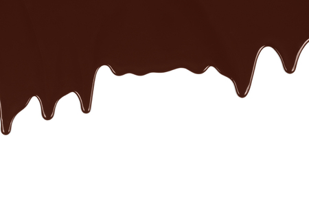 Melted chocolate dripping on white background close-up Imagens