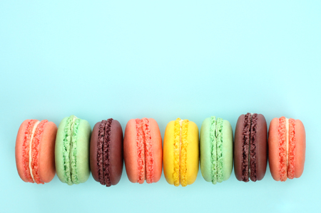 French macaroons on blue background close-up Imagens