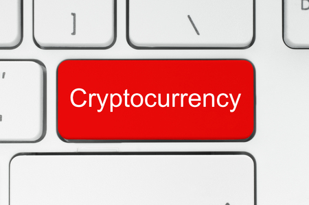 Cryptocurrency concept. Red button with Cryptocurrency word on the keyboard close-up