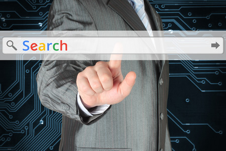 Businessman pushing virtual search bar with color Search word on digital background