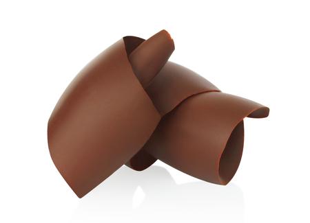 Chocolate shavings on white background close-up
