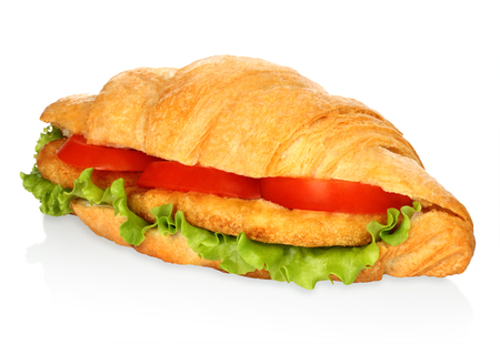 Big croissant with vegetables and chicken meat on white background