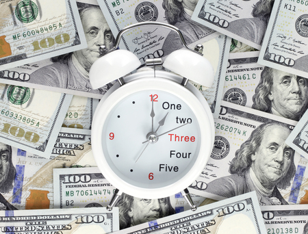 Finance concept - time is money, with hundred dollars banknotes Imagens