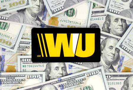 Kiev, Ukraine - September 18, 2018: Western Union logo printed on paper. The Western Union Company is an American financial services and communications company.