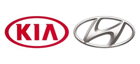 Kiev, Ukraine - November 07, 2018: Logos of car manufacturers alliance: Kia Motors and Hyundai, printed on white paper