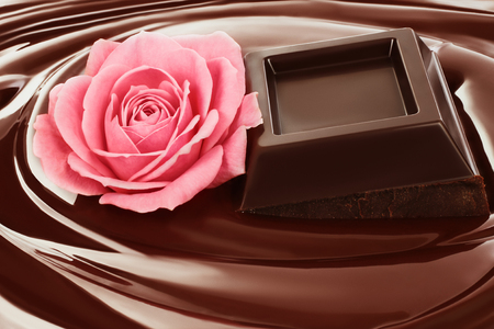 Swirl of melted chocolate with pieces of chocolate bar and pink rose. Dark chocolate packaging design, advertising poster, template Imagens
