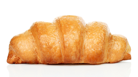 Big fresh croissant on white background close-up Imagens - 116634218