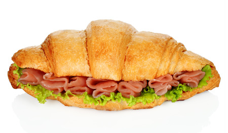 Big croissant with green salad and pork meat on white background Imagens