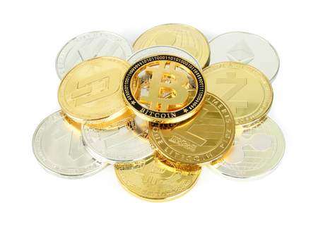 Cryptocurrency coins on white background close-up