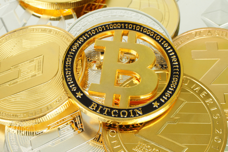 Bitcoin cryptocurrency coin on other cryptocurrency coins background close-up Reklamní fotografie