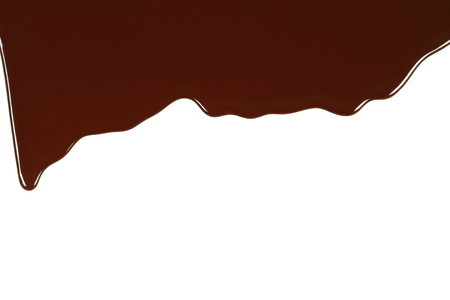 Melted chocolate dripping on white background close-up Reklamní fotografie