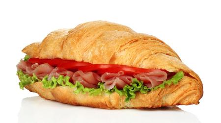 Big croissant with green salad and pork meat on white background Reklamní fotografie