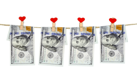 Finance concept - dollar banknotes hanging on a white background Reklamní fotografie