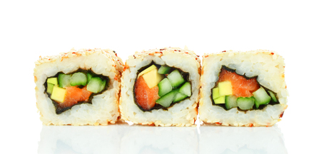Sushi roll pieces with salmon, rice, avocado, cucumber and nori isolated on white background. Delicious japanese food