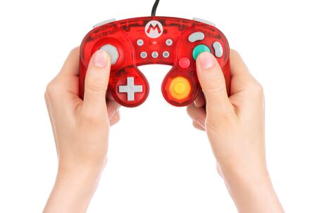 Kiev, Ukraine - May 15, 2019: Woman hands holding Mario GameCube Controller on white background Stock fotó - 137017173