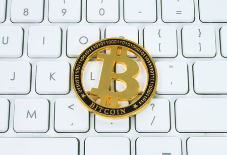 Bitcoin cryptocurrency coin on white keyboard background close-up Stock fotó - 135193085