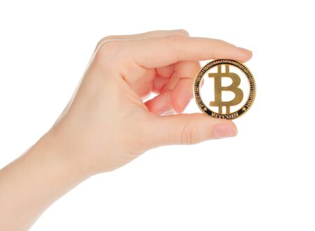 Hand holds Bitcoin on white background close-up Stock fotó - 137950599