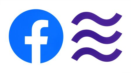 Kiev, Ukraine - October 29, 2019: New Facebook logo with Libra logo printed on paper. Libra is a proposed permissioned blockchain virtual currency by the American social media conglomerate Facebook