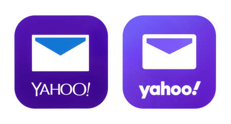 Kiev, Ukraine - November 02, 2019: Collection of old and new Yahoo Mail icons printed on white paper