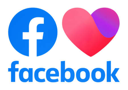 Kiev, Ukraine - November 02, 2019: New Facebook Dating App icon and new Facebook logos, printed on paper. Facebook is a well-known social networking service Editorial