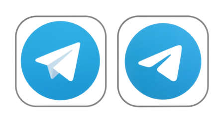 Kiev, Ukraine - November 02, 2019: Old and New icons of Telegram app, printed on white paper. Telegram is a cloud-based instant messaging and voice over IP service Editorial