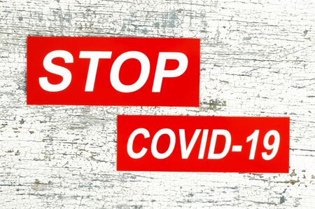 Stop virus Covid-19 concept, on wooden background close-up