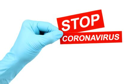 Woman hand in medical gloves holds red sign Stop Coronavirus on white background
