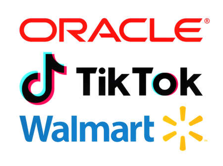 Kiev, Ukraine - September 21, 2020: Oracle, TikTok and Walmart logos, printed on paper. News about deal for Oracle and Walmart to acquire stakes in the US operations of popular video app TikTok.