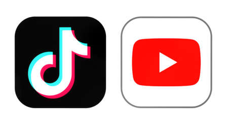 Kiev, Ukraine - September 21, 2020: TikTok and Youtube icons, printed on paper. YouTube announced the launch of a new short-form video experience it's calling YouTube Shorts.