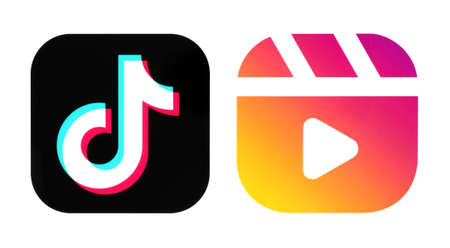 Kiev, Ukraine - September 14, 2020: TikTok and Instagram Reels icons, printed on paper. Instagram launches Reels for making and sharing short videos, it is a clonee of TikTok