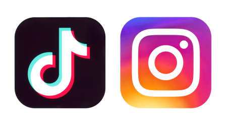 Kiev, Ukraine - September 14, 2020: TikTok and Instagram icons on white background close-up, printed on paper. TikTok is a viral Chinese video-sharing social networking service owned by Chinese company ByteDance Editorial
