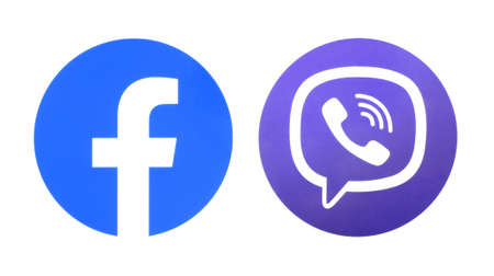 Kiev, Ukraine - September 14, 2020: Facebook and Viber round icons, printed on paper Editorial