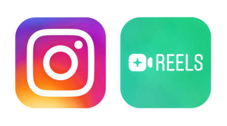 Kiev, Ukraine - September 21, 2020: Instagram and Instagram Reels icons, printed on paper. Instagram launches Reels for making and sharing short videos, it is a clonee of TikTok Editorial