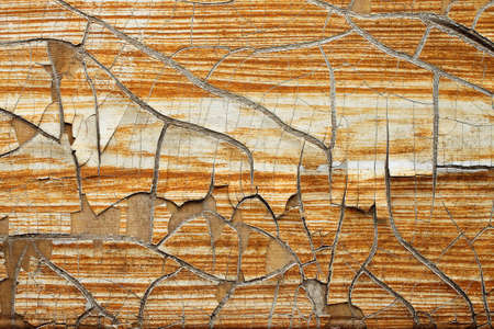Texture background of old wooden board with peeling paint close-up