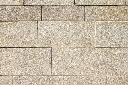 Texture background of ancient bricks wall close-up Standard-Bild