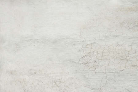 Texture background of white plastered wall with peeling paint close-up Standard-Bild