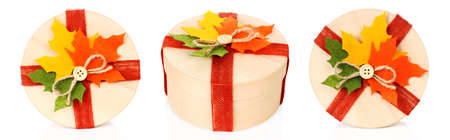 Autumn concept of present boxes with fabric leaves on white backround