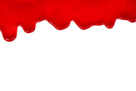 Red ketchup dripping on white background close-up Standard-Bild