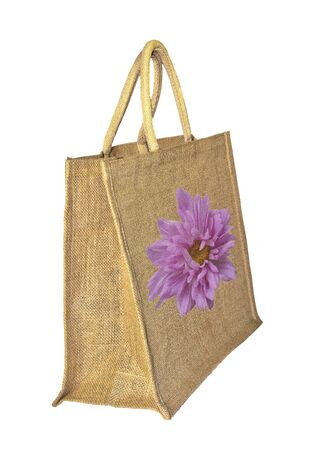 reusable: Reusable burlap or jute shopping bag with pink flower decorated on the white background isolated