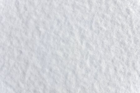 Snow surface texture - winter background with soft and shiny snowflakes Stock Photo