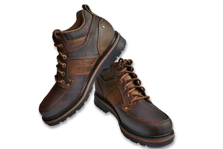 active lifestyle: Brown male leather shoes for people with an active lifestyle over a white background Stock Photo