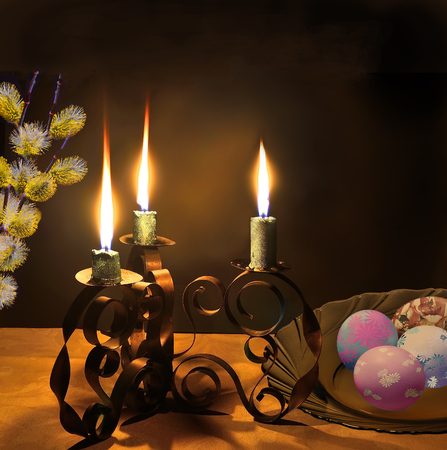 easter candle is burning: Easter night background and the symbols of the Great  Resurrection of Jesus. Candlestick with three burning candles, painted eggs and twigs of willow on the table with a tablecloth covered
