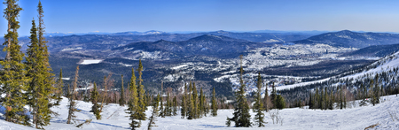 Spring landscape of ski resort Sheregesh, Western Siberia, Russia - panoramic view of the mountains