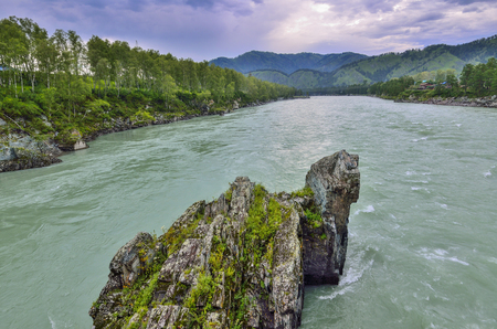 Picturesque summer landscape of fast mountain river with rocky islands in the form of pyramids, as  the ridge of a dragon, Altai mountains, Russia Stock Photo