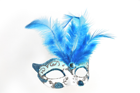 guise: Elegant ladies white masquerade mask with sequins, blue glass bead and feathers close up  on a white background isolated