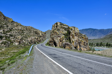 Mountain landscape - road paved in colorful rocks of Altai. Chuysky tract - one of the most beautiful scenic routes in Russia