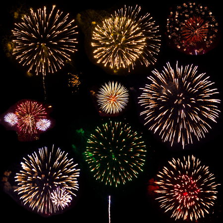 Colorful set of nine exploding fireworks, isolated on black background. Bright fire flowers of festive fireworks  various colors and shapes at night sky. Holidays concept 免版税图像