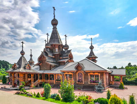 Novokuznetsk, Russia - July 29, 2019: Christian Temple of the Holy Martyr John the Warrior. Vintage technologies for the construction in traditions of wooden architecture of Russian North
