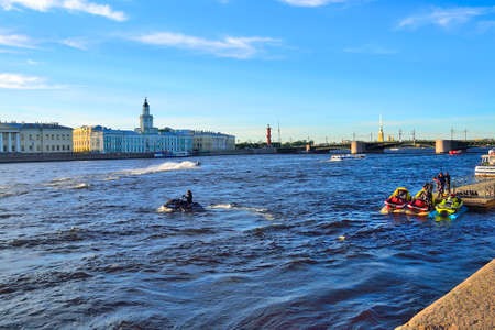 St. Petersburg, Russia - June 13, 2019: Boat trips and excursions for tourists on the Neva river by launch and jet skiing. Young guys on jet-ski or water scooter riding