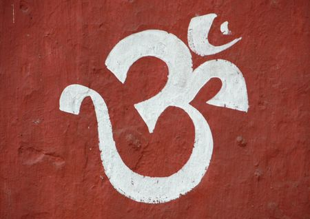 Grafitti: Sanskrit Om painted on a wall in the Jainist Mirrored Temple Compound, Kolkata, India
